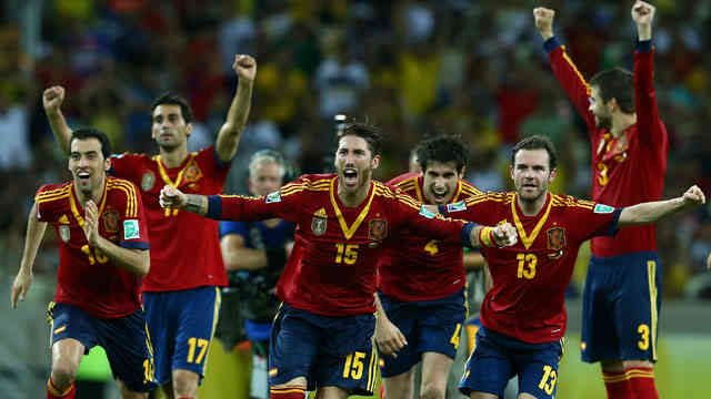 Spain celebrate their goal as they beat Italy in the semi-finals of the Confederation Cup