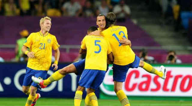 Zlatan celebrates with his team mates with his goal