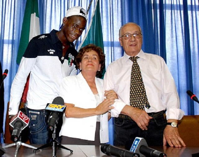 Balotelli with his proud foster parents as he gains Italian citizenship.
