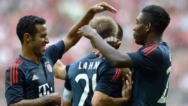 Lahm celebrates his goal with his team mates
