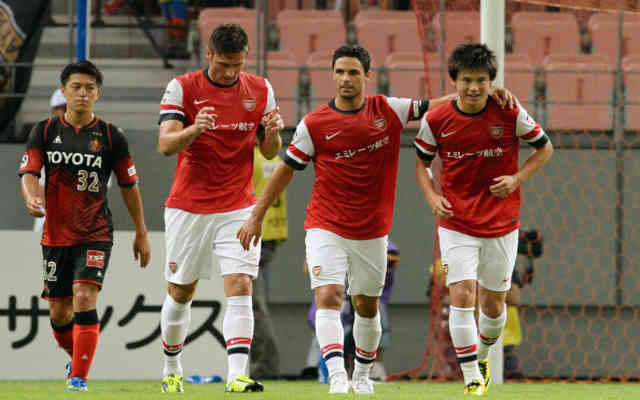Miyaichi celebrates his goal with his team mates in Japan