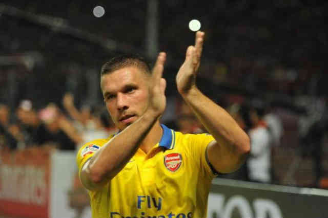 Podolski celebrates his match in Indonesia