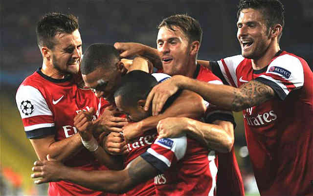 Arsenal celebrate their victory at the play off of the Champions League Qualifications