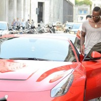 Balotelli in his new car, a red Ferrari F12 Berlinetta, going on a shopping spree in Milan.