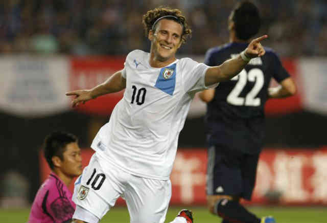 Forlan celebrates his amazing goals against Japan