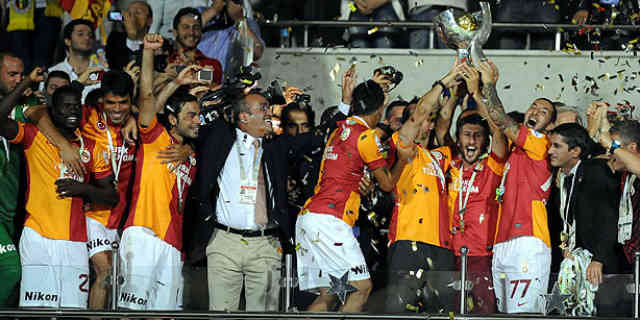 Galatasaray celebrate their win with the Super Cup