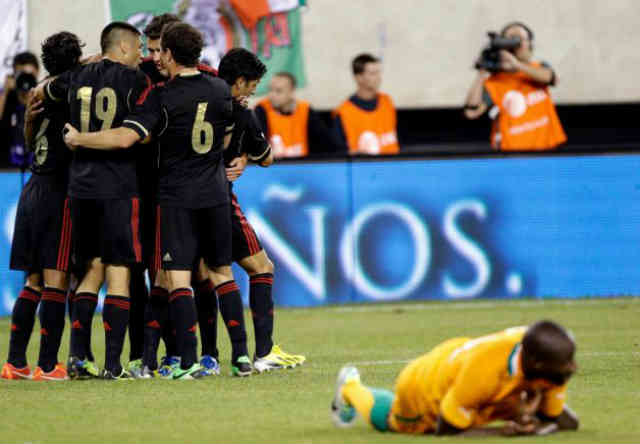 Mexican players celebrate their win against Ivory Coast