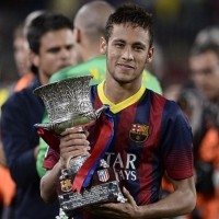 Neymar with the Supercopa trophy after Barcelona have claimed the Spanish Supercopa with 0-0 draw with Atletico Madrid in the second leg at the Nou Camp.-football