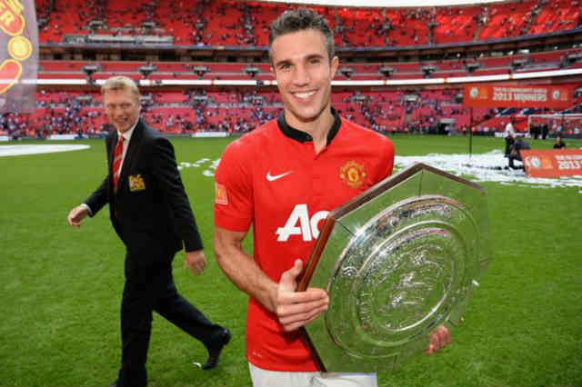 Robin Van Persie celebrates his victory with Manchester United