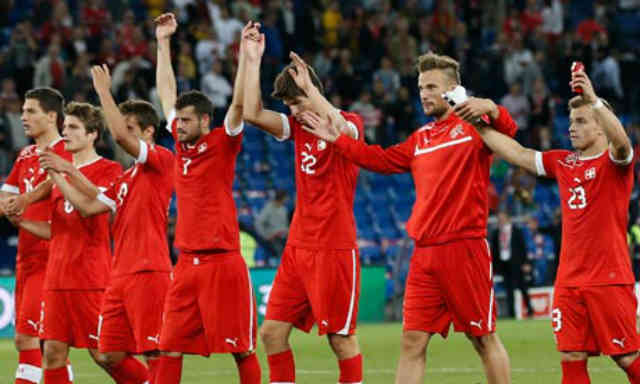 The Swiss celebrate their victory against the world class Brazil