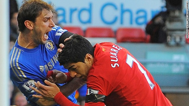 This is the moment when Luis Suarez bites Ivanovic's arm during a football game against Chelsea