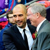 Management greats Pep Guardiola and Sir Alex Ferguson share a handshake