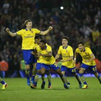 Arsenal celebrate as they take it in penalties