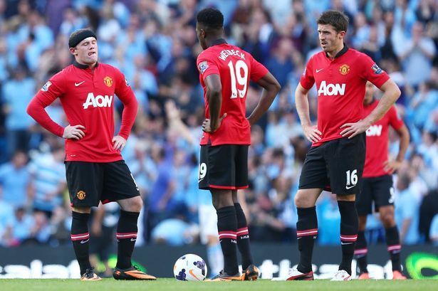 Manchester United players dejected in loss to neighbours City.