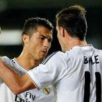 Ronaldo celebrates his goal with new team mate, Gareth Bale