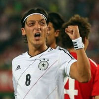 German Superstar Mesuit Ozil celebrates