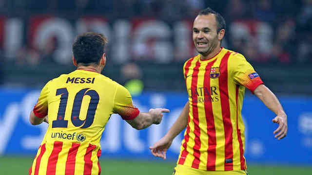 Lionel Messi celebrates his goal with Iniesta against AC Milan