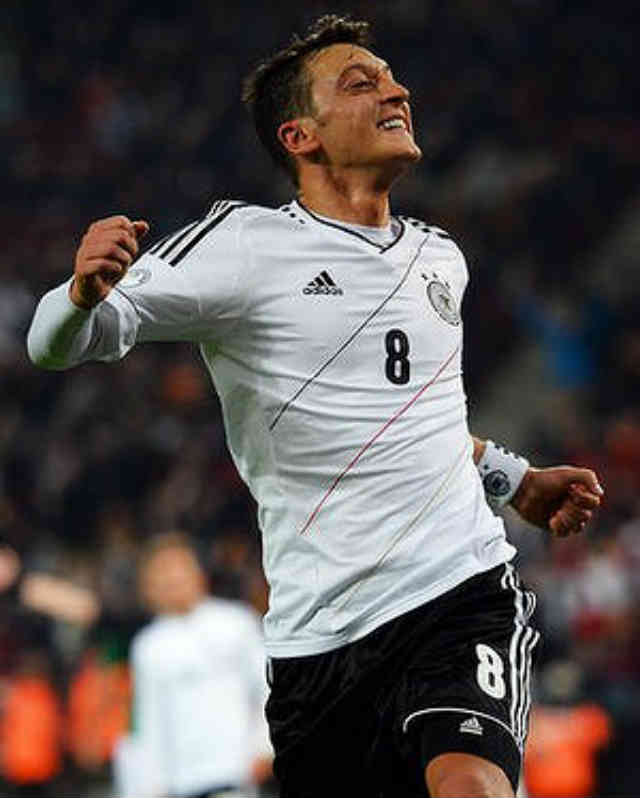 Mesut Ozil celebrates his smashing goal as he celebrates for taking Germany to the World Cup