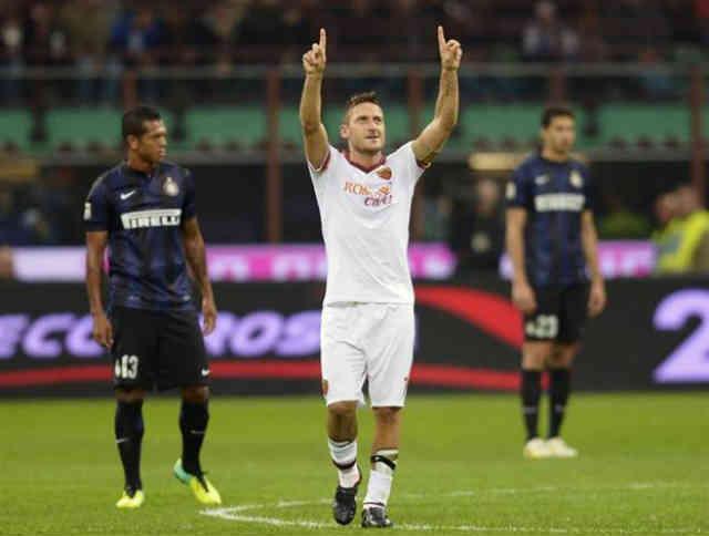 Totti celebrates his smashing goal against Inter Milan