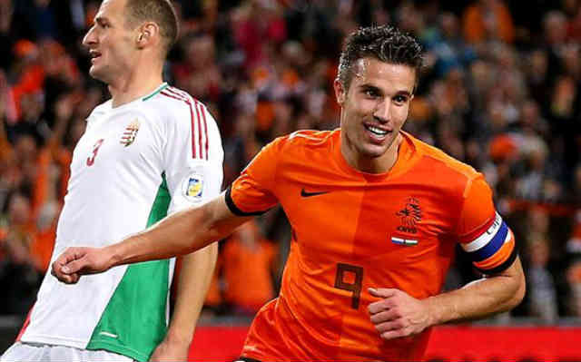 Van Persie celebrates and Holland qualify to the World Cup