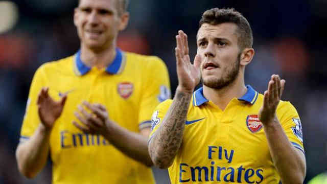 Wilshere celebrates the game as he give Arsenal hope for a draw