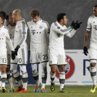 Bayern Munich celebrate their win and get through to the next stage of the Champions League