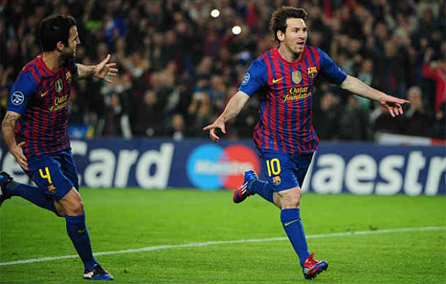 Lionel Messi once again celebrates his two goals against AC Milan in the Champions League
