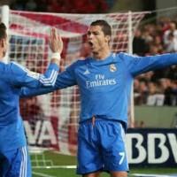 Ronaldo and Bale both celebrate their goals against Almeria