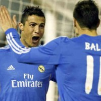 Ronaldo celebrates with his team mate Gareth Bale with his goal