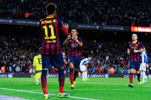 Sanchez celebrates with his team mate Neymar