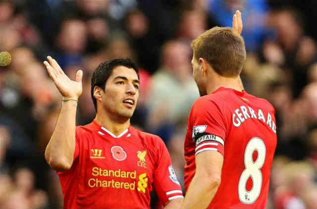 Suarez celebrates with his team mate Gerrard