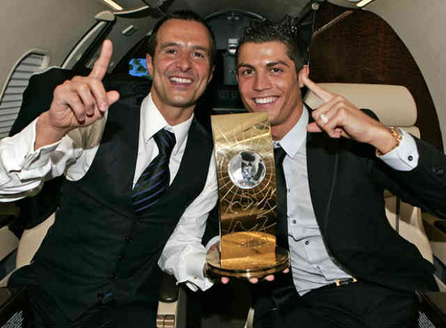Jorge Mendes celebrates with Ronaldo his award