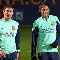 Messi with his team mate Neymar, back in training after his injury