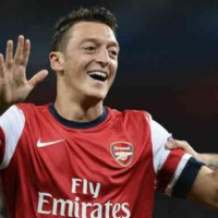 Mesut Ozil is happy to be with the Gunners