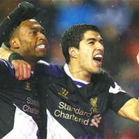 Suarez and Sturridge both celebrate their goals against Stoke City