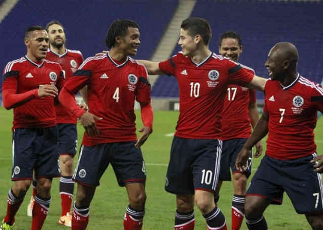 Colombian team celebrate their goal but was not enough to win their match